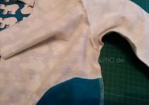 Ärmel- und Seitennaht verschlossen, Taschenbeutel von innen