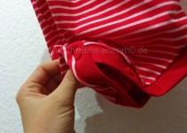 Verschluss: rote KAM-Snaps